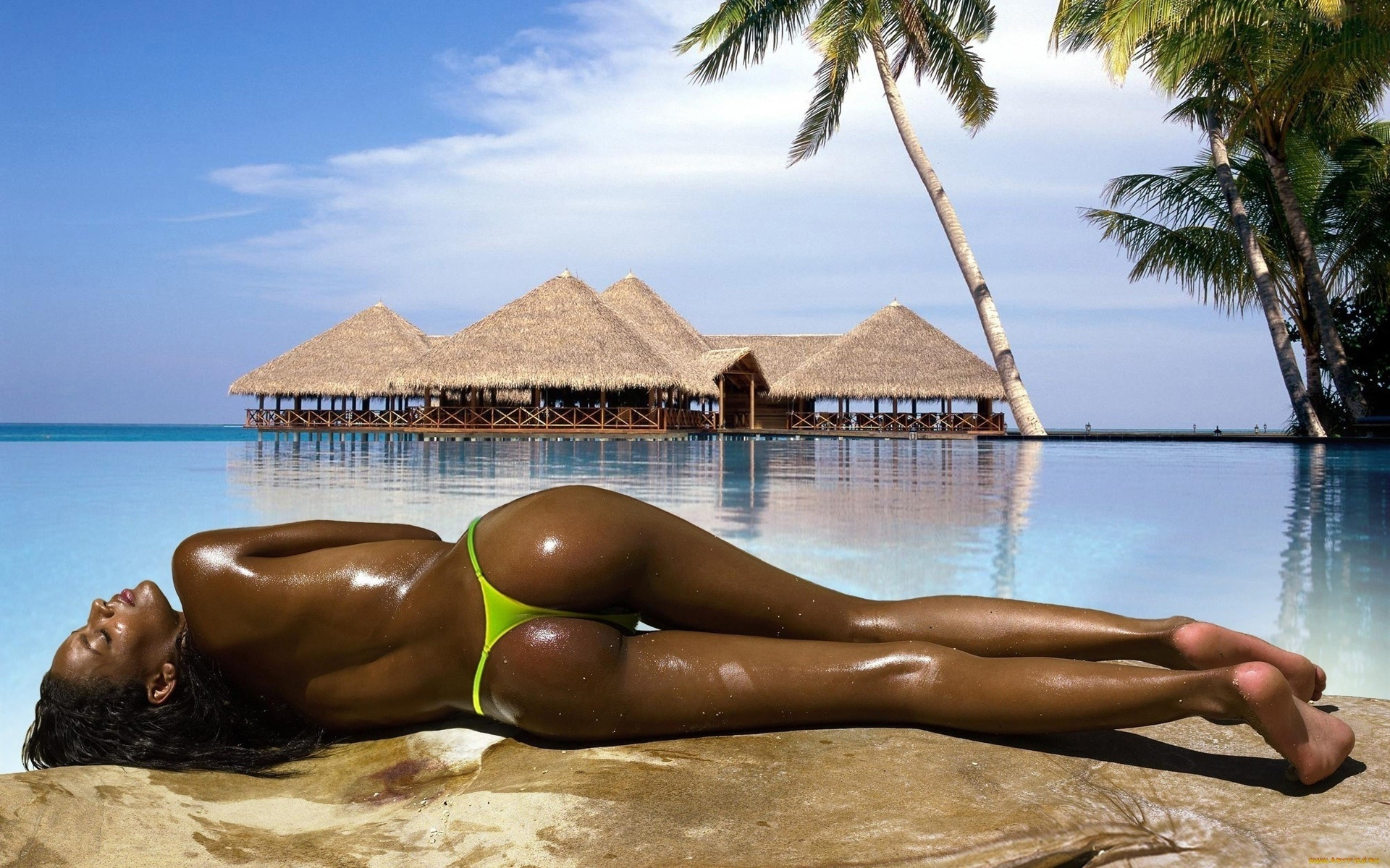 Фото африканок без купальников, Африканка загорает на шезлонге без бикини 27 фотография