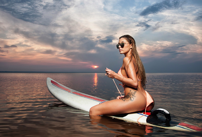 Anastasia Manova, women, sea, blonde, bikini, tattoo, hips, ass, sitting, sunglasses, glasses, women with glasses, back, long hair, sunset, sky, clouds, water, wet hair, water drops, wet body