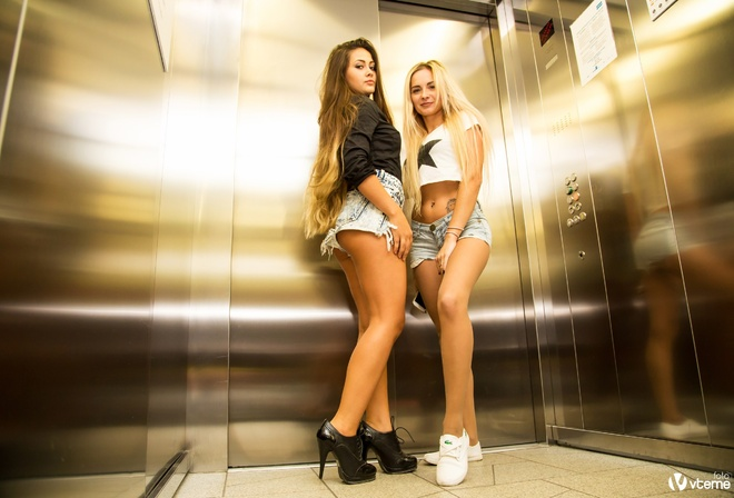 women, elevator, blonde, high heels, sneakers, belly, tattoo, long hair, black shirt, T-shirt, jean shorts, ass, pierced navel, painted nails, reflection, tanned