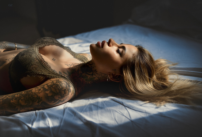 women, bra, Giovanni Zacche, tanned, tattoo, closed eyes, blonde, lying on back, in bed, eyeliner, portrait