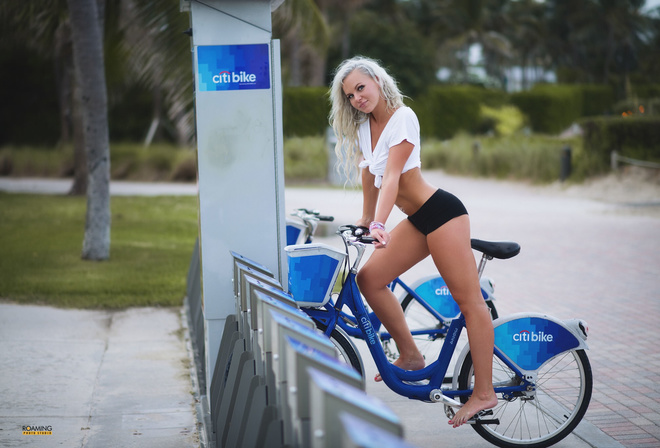 women, blonde, smiling, short shorts, tanned, pierced navel, belly, women outdoors, women with bicycles, palm trees