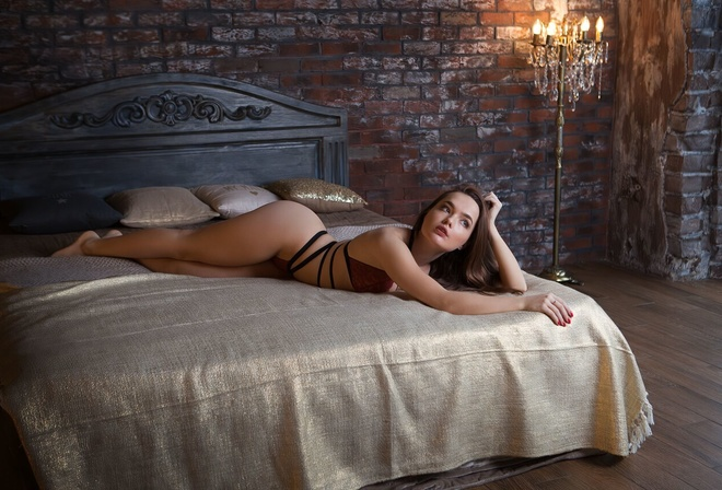 women, in bed, red lingerie, wall, bricks, red nails, looking away, lamp