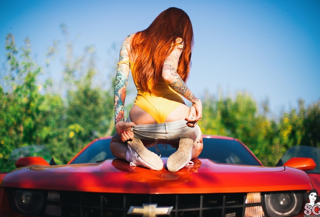 Elune Suicide, women, model, redhead, long hair, back, bodysuit, monokinis, ass, jean shorts, kneeling, sneakers, depth of field, Chevrolet, Chevrolet Camaro, Camaro, car, red cars, vehicle, women with cars, inked girls, tattoo, outdoors, women outdoors,