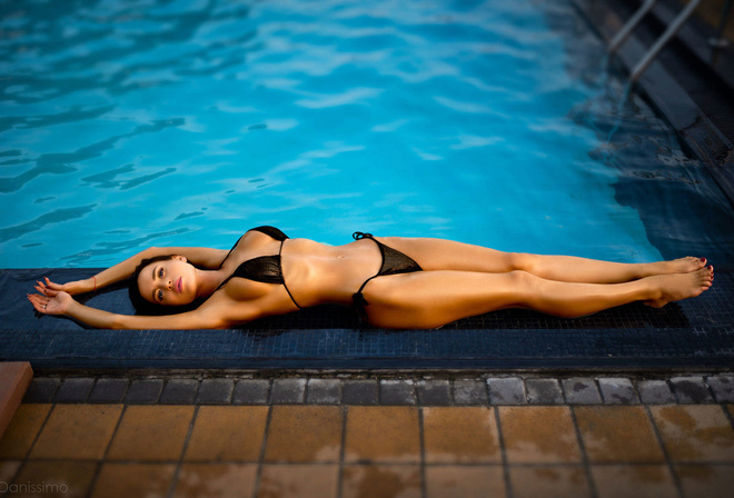 women, tanned, swimming pool, women outdoors, black bikini, belly, armpits, ribs, lying on back, red nails, pink lipstick, hips