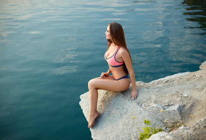 women, bikini, rocks, water, sitting, women outdoors, long hair, painted nails, looking away, cleavage, brunette, ass