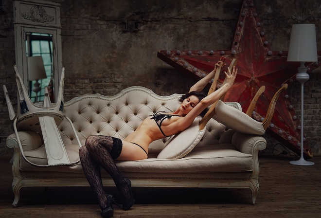 women, sitting, couch, closed eyes, black lingerie, mirror, reflection, wall, wooden floor, high heels, belly, armpits, red lipstick, chair, lamp, light bulb, women indoors, arched back, sideboob, arms up, fishnet