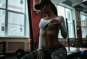 Angelica Anderson, women, model, brunette, sitting, pierced navel, pants, underboob, gyms, tattoos, flat belly, camouflage, boobs, strategic covering, baseball caps, Alexander Belavin