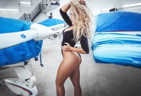 women, blonde, ass, one-piece, tanned, side view, curvy, wavy hair, hangar, airplane, black clothing, Fotoshi Toshi aka Anton Harisov