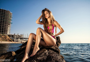 Liubov Guliak, women, model, brunette, sitting, ass, long hair, wavy hair, sea, water, stone, beach, hands on head, portrait, sky, building, swimwear, closed eyes, blonde, Alexander Mospan