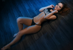 women, tanned, top view, belly, wooden surface, on the floor, T-shirt, blac ...