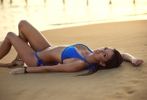 women, Ana Segura, tanned, blue bikinis, sand, looking at viewer, lying on back, women outdoors, eyeliner, water drops