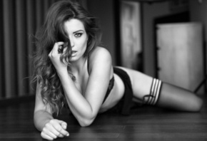 women, monochrome, black lingerie, lying on front, on the floor, wooden surface, hair in face, garter belt, stockings