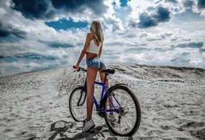women, bicycle, ass, blonde, tanned, jean shorts, sand, sky, clouds, back, sneakers