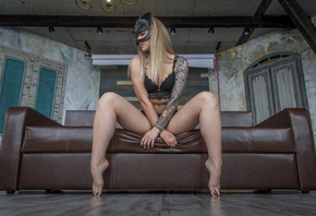 women, brunette, black nails, mask, sitting, blonde, tattoo, couch, belly, arms crossed, rear view, looking away