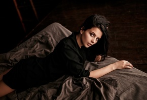 women, in bed, portrait, black clothing, lying on front, red nails
