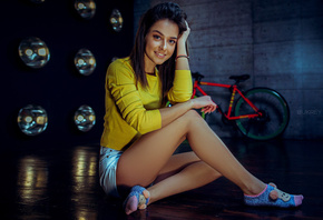 women, sitting, smiling, on the floor, brunette, bicycle, jean shorts, socks