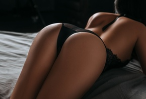 women, tanned, ass, black lingerie, bottom up, in bed, lying on front