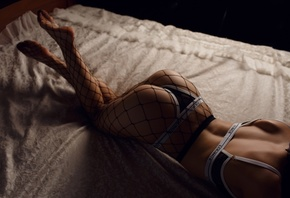 women, lingerie, in bed, bottom up, tanned, fishnet lingerie, arched back, ass, lying on front
