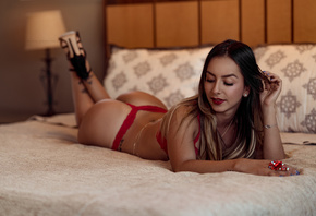 women, red lingerie, high heels, tan lines, tattoo, in bed, red lipstick, pillow, lying on front, ass, nose ring, pierced nose, blue nails, smiling