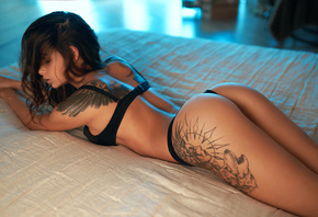 women, brunette, ass, black lingerie, in bed, lying on front, tattoo, hair in face