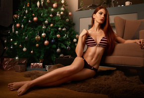women, brunette, portrait, lingerie, Christmas, long hair, sitting, belly, on the floor, looking away, presents, Christmas Tree, pierced navel, redhead