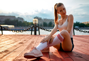 women, jean shorts, tank top, sitting, sneakers, women outdoors, white stockings