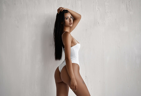 women, ass, bodysuit, tanned, long hair, wall, tattoo, looking at viewer, painted nails