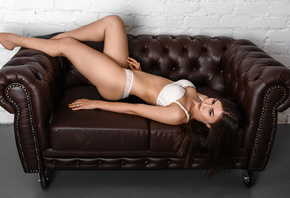 women, white lingerie, ass, brunette, couch, belly, wall, bricks, looking away