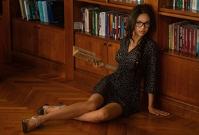 women, black dress, ponytail, sitting, on the floor, women with glasses, high heels, pink nails, books, library