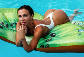 women, swimming pool, white swimsuit, one-piece swimsuit, wet hair, wet body, ass, tan lines, Inflatable Chair, women outdoors, painted nails, blue eyes, brunette