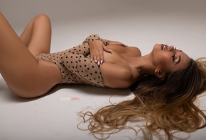 Liubov Guliak, women, Kirill Zakirov, brunette, closed eyes, covering boobs, polka dots, simple background, bodysuit, hands on boobs
