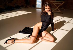 women, sitting, hips, on the floor, women indoors, finger on lips, high heels, mirror, bricks, black dress, brunette