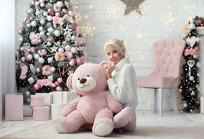 women, Katerina Shiriaeva, brunette, blonde, hairbun, Katerina Shiryaeva, Christmas Tree, Christmas, women indoors, presents, sitting, smiling, teddy bears, chair, wall, bricks, white sweater, wooden floor