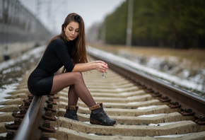 women, sitting, shoes, women outdoors, black clothing, long hair, railway, black skirts, glasses