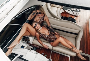 women, yacht, animal print, sitting, two women, blonde, brunette, top view, one-piece swimsuit, tattoo, high heels, sunglasses, hoop earrings, hips
