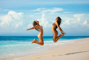 women, jumping, beach, ass, sky, clouds, two women, sand, sea, smiling, rib ...