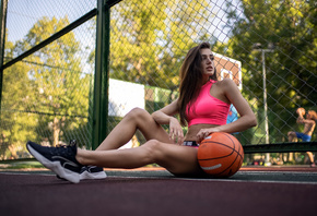 women, basketball court, sportswear, ball, women outdoors, sneakers, trees, sitting, belly, looking away