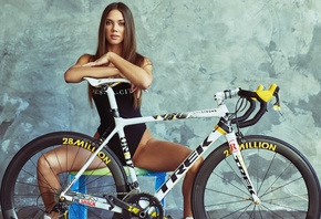 women, women with bicycles, bodysuit, smiling, sitting, bicycle, wall, wooden floor, brunette, arms crossed, spread legs, sneakers, women indoors