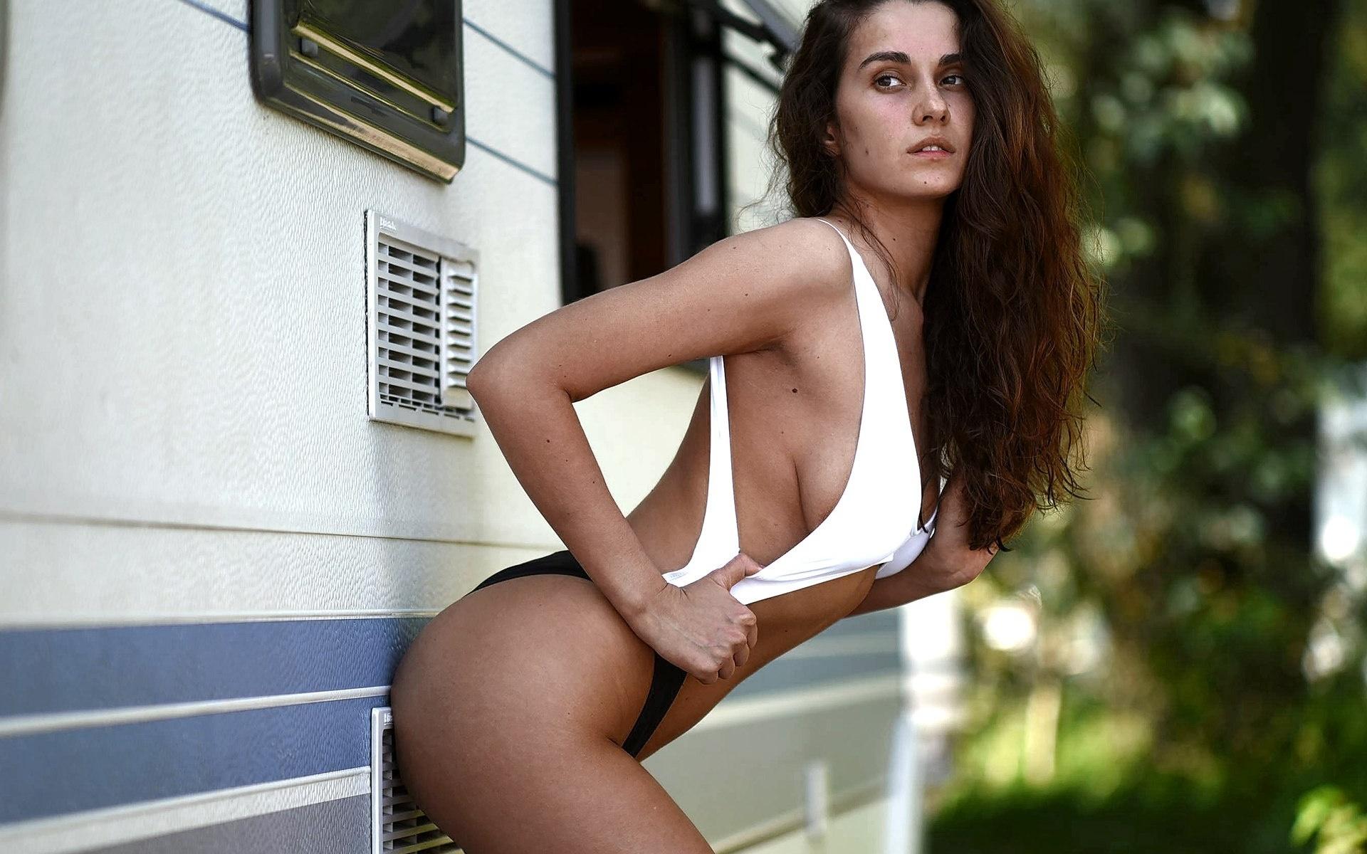kate petrova, women, model, brunette, sideboob, looking away, ass, one-piece swimsuit, wavy hair, armpits, women outdoors