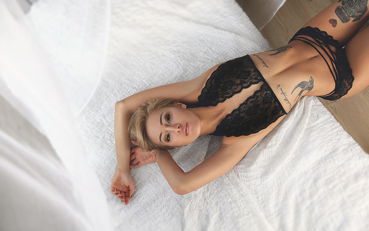 ksenia kostrovskaya, women, blonde, black lingerie, belly, top view, short hair, the gap, hips, brunette, tattoos, armpits, in bed, looking at viewer
