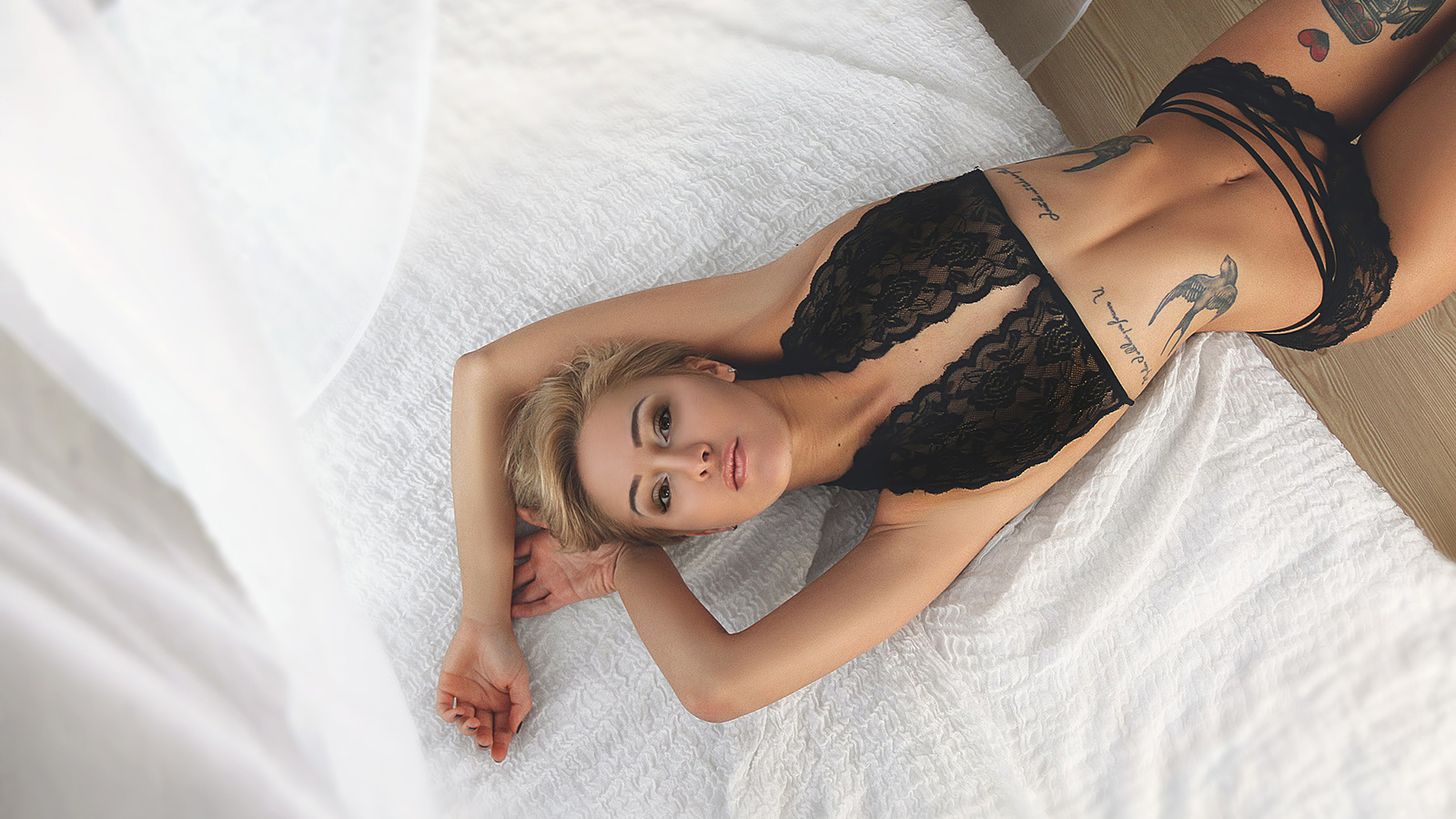 ksenia kostrovskaya, women, blonde, black lingerie, belly, top view, short hair, the gap, hips, brunette, tattoos, armpits, in bed, looking at viewer