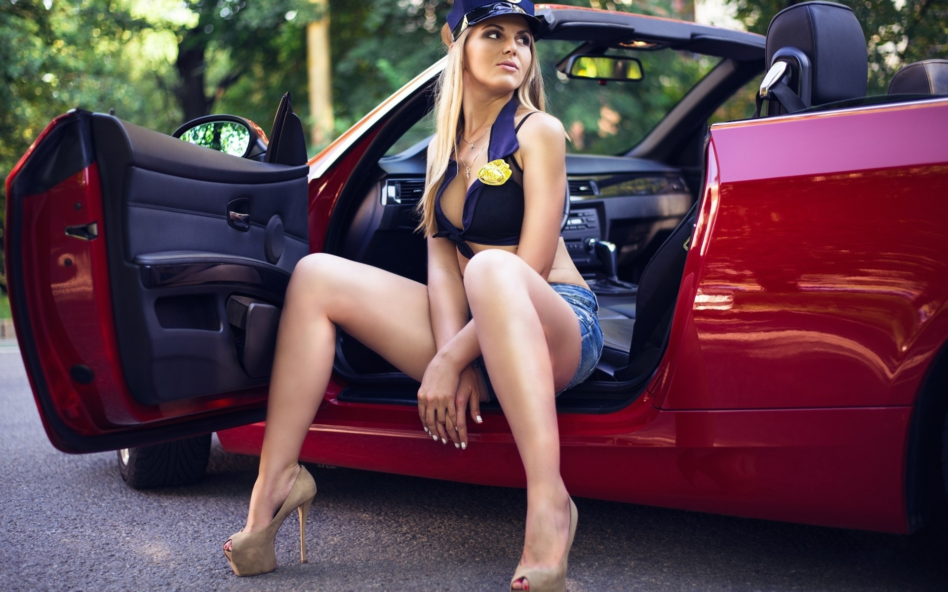 Women posing on cars 15