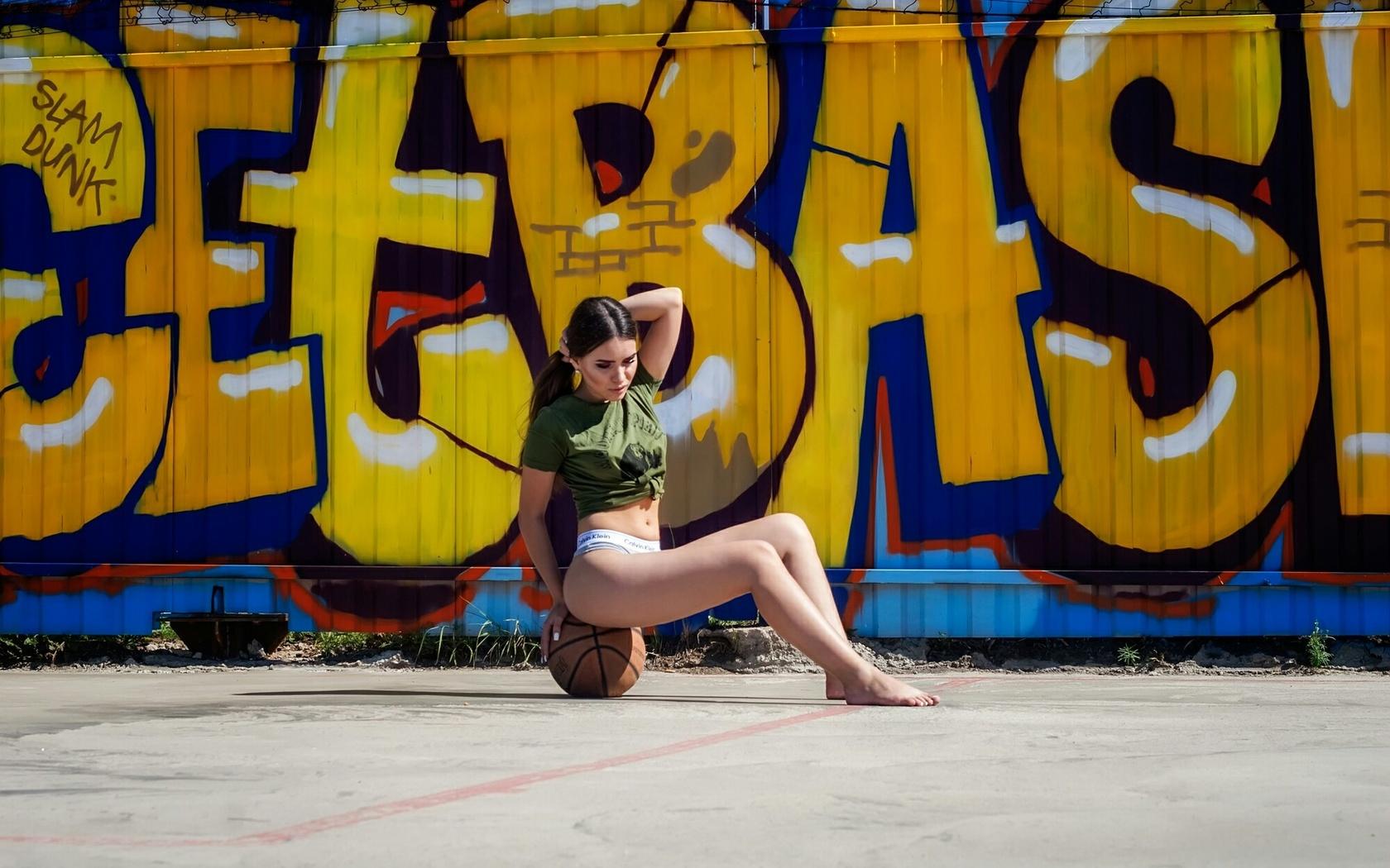 women, t-shirt, ball, sitting, calvin klein, belly, women outdoors, graffiti, brunette