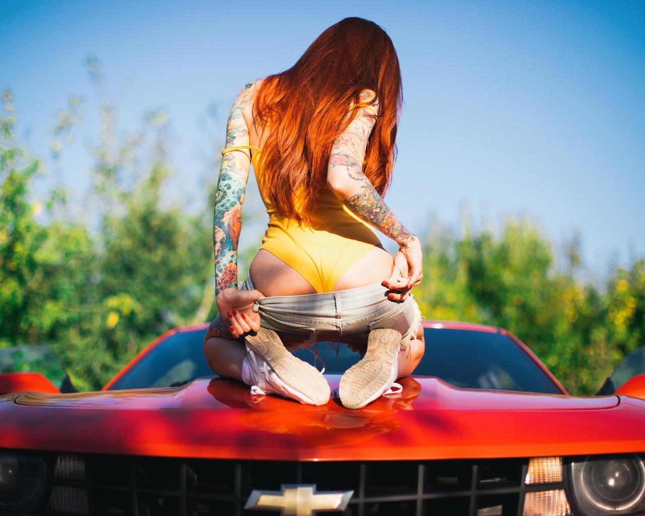 elune suicide, women, model, redhead, long hair, back, bodysuit, monokinis, ass, jean shorts, kneeling, sneakers, depth of field, chevrolet, chevrolet camaro, camaro, car, red cars, vehicle, women with cars, inked girls, tattoo, outdoors, women outdoors,