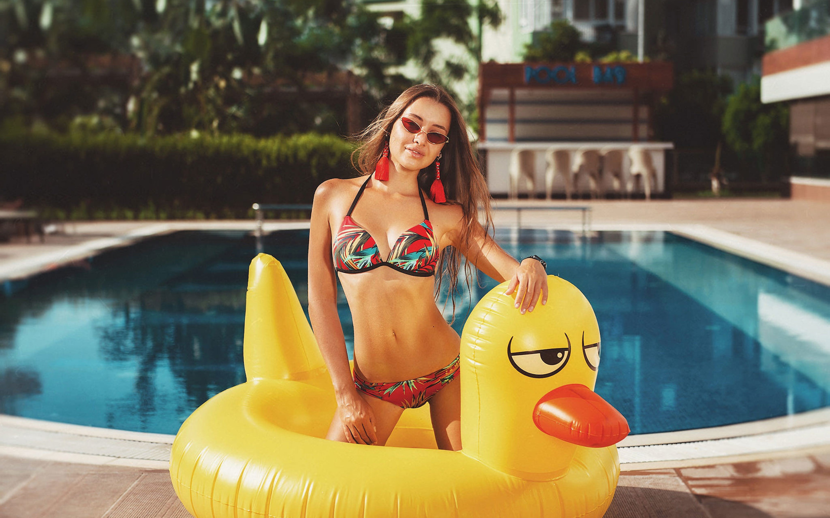 women, kneeling, bikini, sunglasses, swimming pool, inflatable chair, watch, belly, women outdoors, smiling, brunette