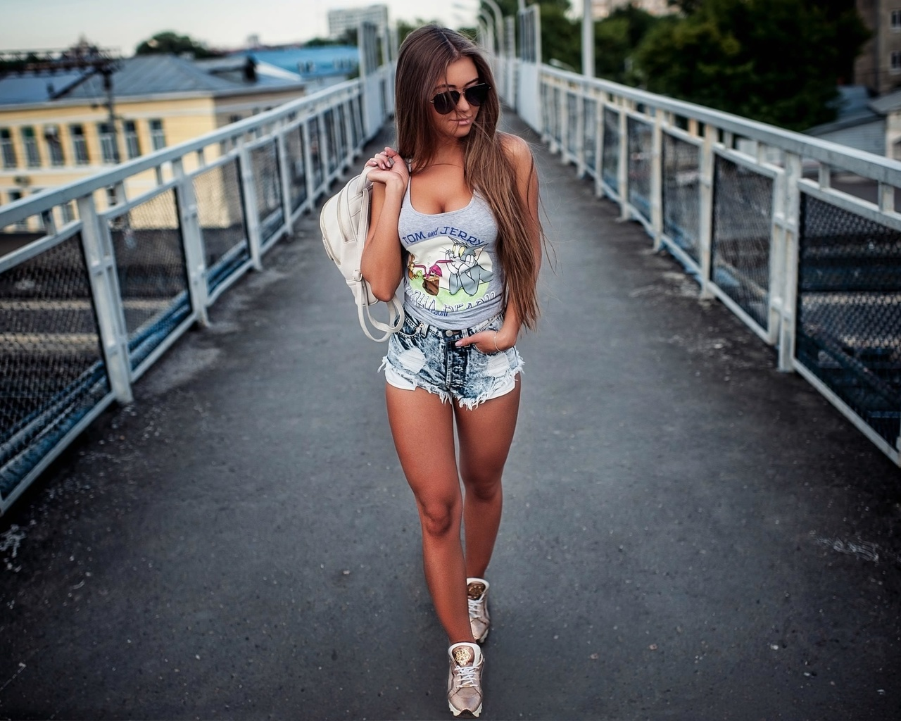 women, tank top, jean shorts, tanned, women outdoors, sunglasses, bridge, handbags, sneakers, long hair, railway, brunette