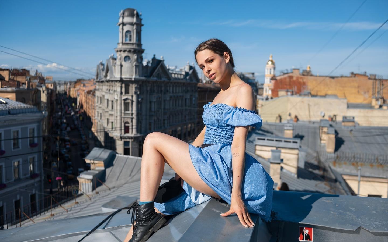 women, sitting, blue dress, women outdoors, sky, bare shoulders, shoes, cityscape, rooftops, socks