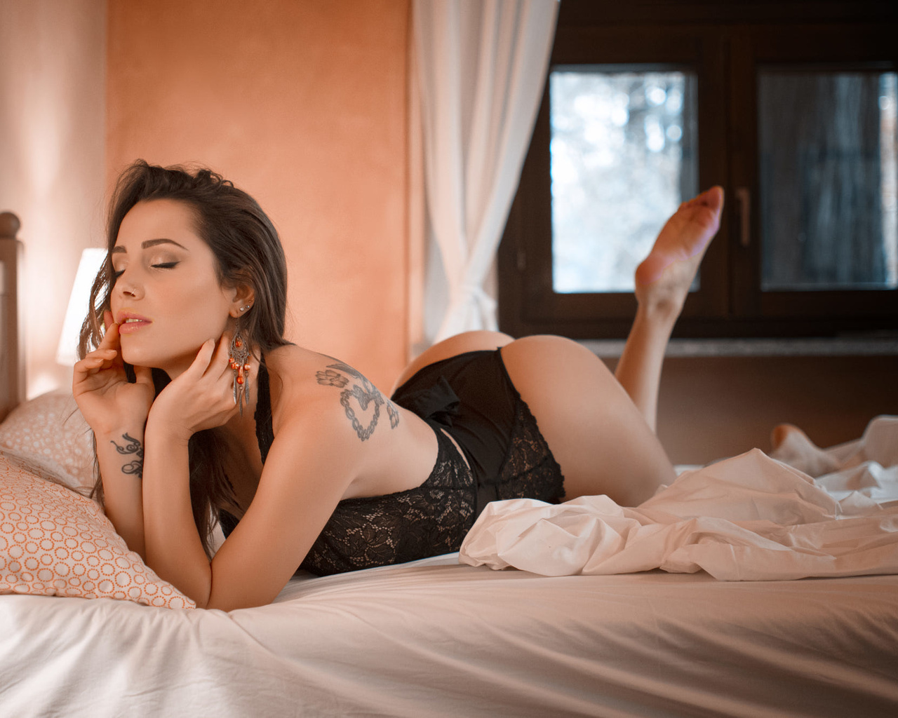 women, ass, body lingerie, window, tattoo, closed eyes, in bed, pillow, black lingerie, arched back, lamp, women indoors, feet in the air