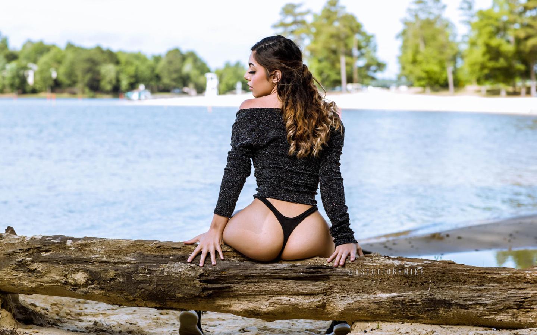 women, sitting, ass, back, women outdoors, sneakers, water, trees, black panties, brunette