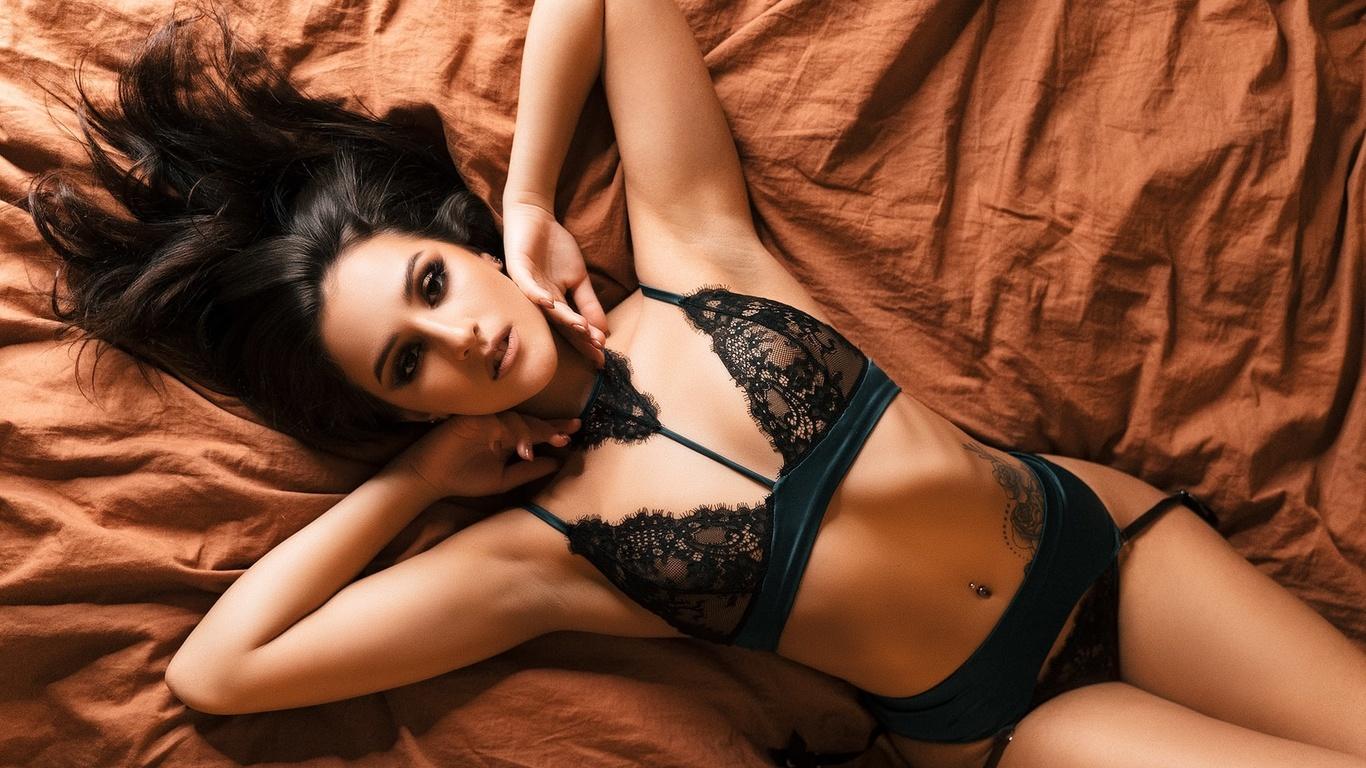 women, black lingerie, top view, tattoo, belly, pierced navel, armpits, brunette, garter belt, ribs, lying on back, see-through lingerie, see-through bra, black lingerie
